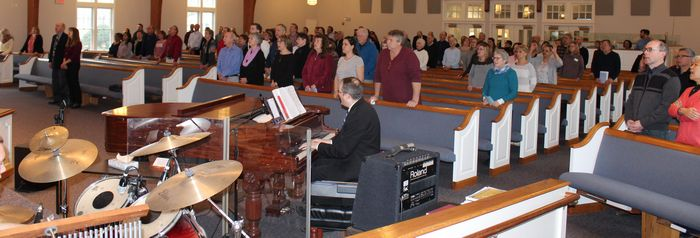 Chris Morris at the piano during worship